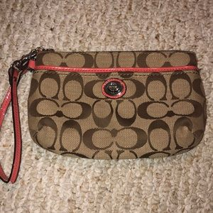 tan and pink coach wristlet/wallet